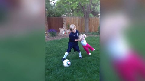 Boy Teaches Sister How To Play Soccer