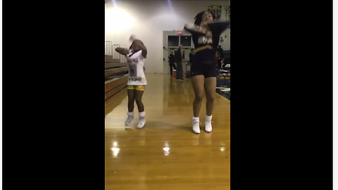 Check Out This Priceless Moment When A Little Girl Joins In On Big Sister's Cheer Solo