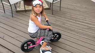 Clever girl uses hoverboard to power pedal-less bike - Video