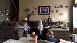 Kids 'sabotage' mother's workout attempt - Video