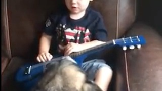Toddler serenades ABC's and shows off guitar skills to his Dog  - Video