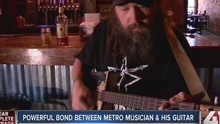 Powerful bond between a Kansas City musician and his cigar box guitar - Video