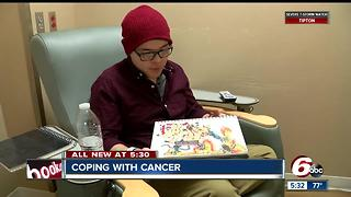 This student has a unique way to cope with cancer: Art - Video