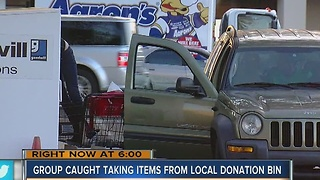 Group caught taking items from local donation bin - Video