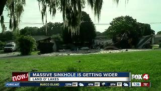 Officials: Massive sinkhole in Pasco County is getting bigger - Video