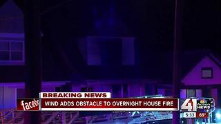 Police arrest man at scene of KCMO house fire - Video