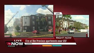 3-alarm fire burning at apartments near USF - Video
