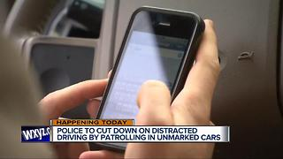 Police to cut down on distracted driving by patrolling in unmarked cars - Video