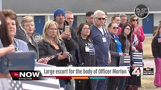 Community gathers to salute fallen officer - Video