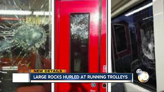 Large rocks hurled at running trolleys - Video