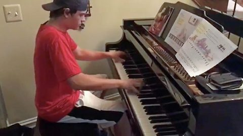 Large pizza with a side of beethoven: Teen age delivery boy blows family away with impromptu performance on classical piano