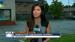 Woman carjacked in the parking lot of Greenfield liquor store - Video