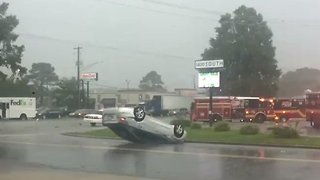 Severe Thunderstorm Flips Over Cars In Front of Strip Mall - Video