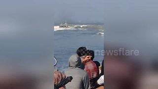 Moment heavy waves cause boat to capsize leaving seven dead - Video