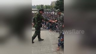 Chinese student in military drill fail - Video