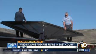 Winds blow gazebo onto roof in East County - Video