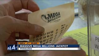 Customers flock to lucky store for Mega Millions tickets - Video