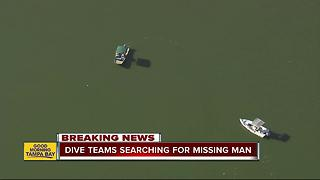 Dive teams search for missing jet skier - Video