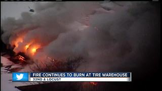 Fire crews still on the scene of tire warehouse fire - Video
