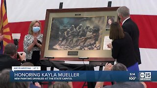 Officials unveil painting dedicated to Kayla Mueller