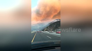 Driver captures dramatic footage of fast-moving California fire - Video
