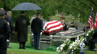 Officer Lehner's casket arrives at Forest Lawn Cemetery - Video