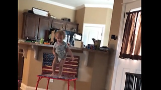 Ambitious toddler thinks he can fly - Video