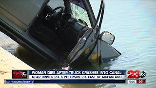 Woman dies after truck crashes into canal