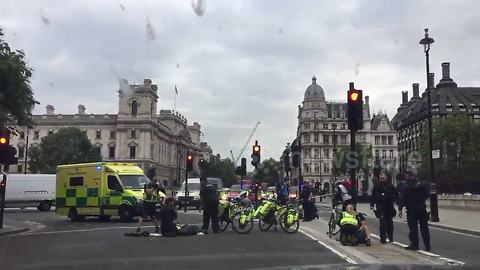Paramedics treat cyclists in Westminster after car ploughs into barriers