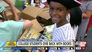 College students donate thousands of books to grateful kids