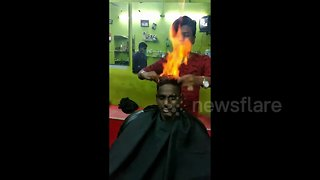 Drop the scissors! Indian barber trims customer's hair by setting it on FIRE