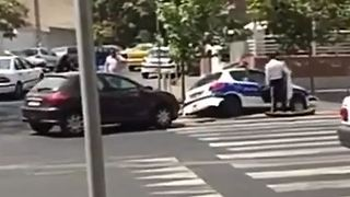 Woman crashes into a police car - Tehran - Video