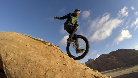 That's wheelie risky! Stuntman performs death-defying unicycle tricks in desert