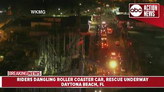 Florida firefighters working to rescue riders from dangling rollercoaster car