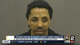 Man wanted in infant son's death turns himself in - Video