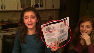Surprise tickets send this girl into tearful hysterics. What could they be?