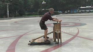 Retired carpenter invents strange wooden vehicle - Video