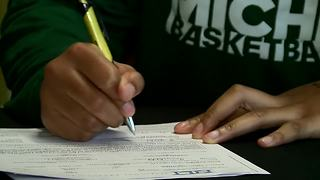 Kiara Johnson signs scholarship - Video