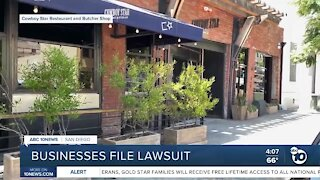 Businesses file lawsuit over restrictions