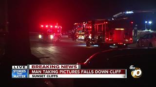 Man taking pictures falls off Sunset Cliffs - Video