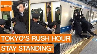Stony-Faced Passenger Squeezes Onto Tokyo Subway During Rush Hour - Video