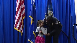 Local girl honored for helping officers - Video