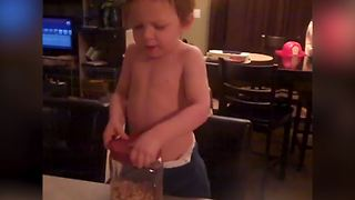 Funny Little Boy Loves Eating Nuts