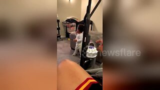 Dad startles adorable baby into walking with vacuum cleaner