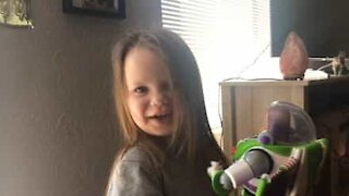 Little girl super happy with Buzz Lightyear toy