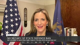 Secretary of State defends firearms ban at polls