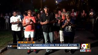 Community members hold vigil for murder victims - Video