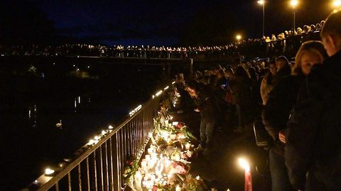 Hundreds of mourners turn out to candlelit vigil for student Tom Jones found dead in river
