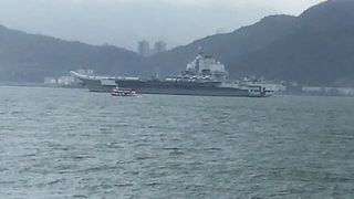 China's First Aircraft Carrier Spotted in Hong Kong - Video