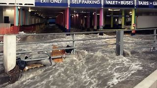 Floodwaters Rush Through Las Vegas Parking Lot After Unusual Rainfall - Video